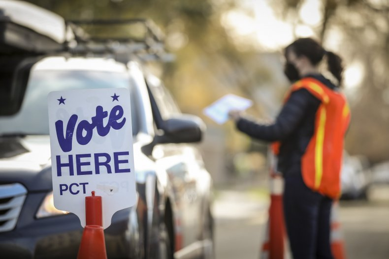 Person votes at drive-thru polling station