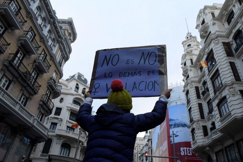 Woman in Spain holds rape placard