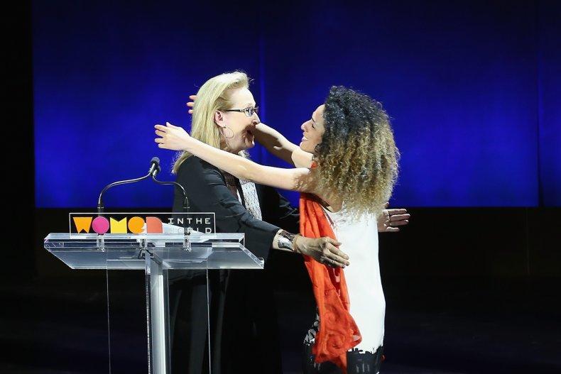 Masih Alinejad  embracing Meryl Streep on stage.