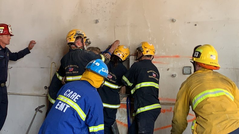Woman trapped between two buildings freed