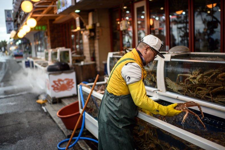 South Korea seafood restaurant worker
