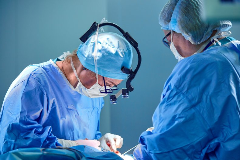 A surgeon performs liposuction