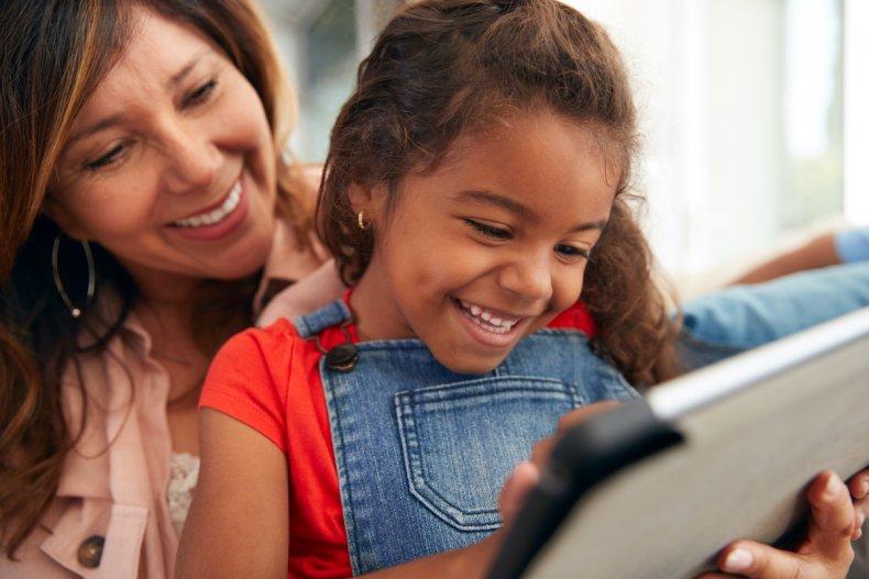 Happy kid with iPad