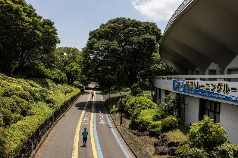 Joggers near Tokyo's Komazawa Olympic Park Stadium.