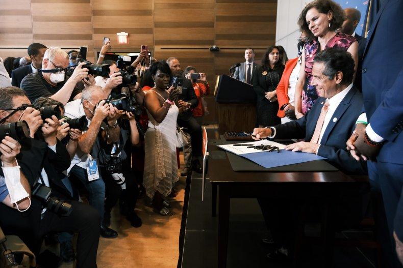 Cuomo signs a bill regarding gun violence.