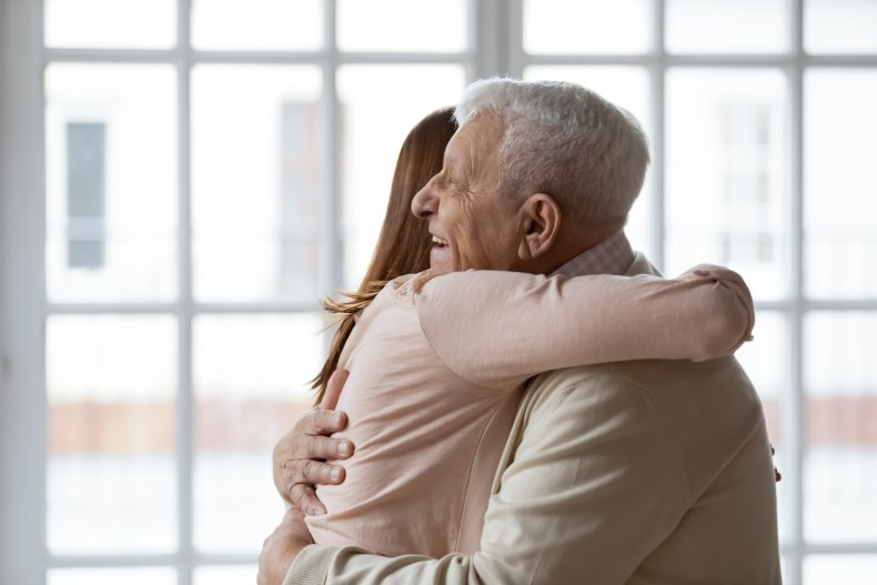 Woman and father hugging