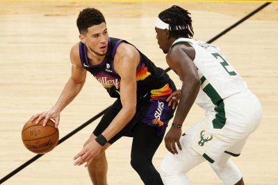 Devin Booker and Jrue Holiday
