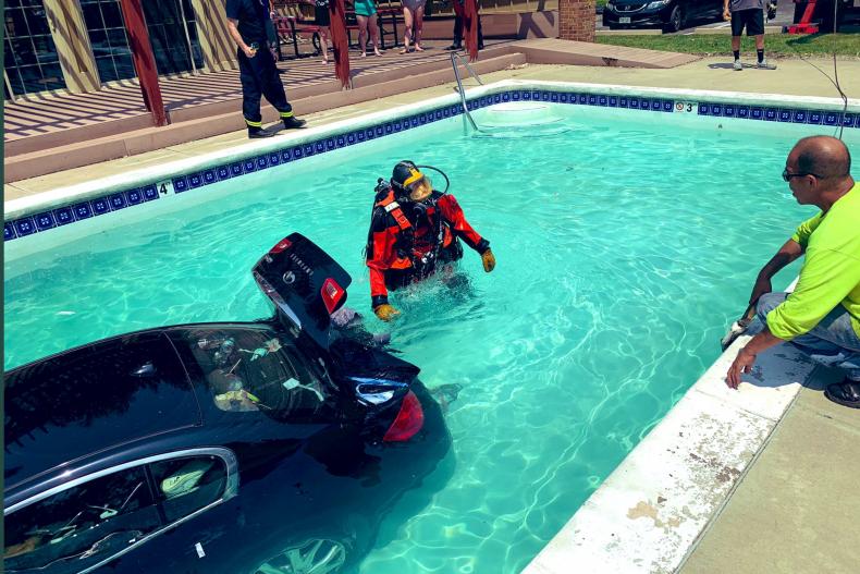 Car submerged in pool