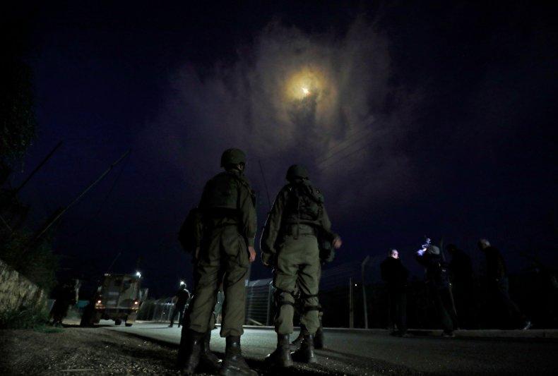Israeli, soldiers, stand, under, flares, Lebanon, border