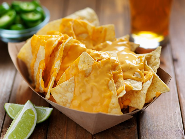 Nachos with cheese on top and lime