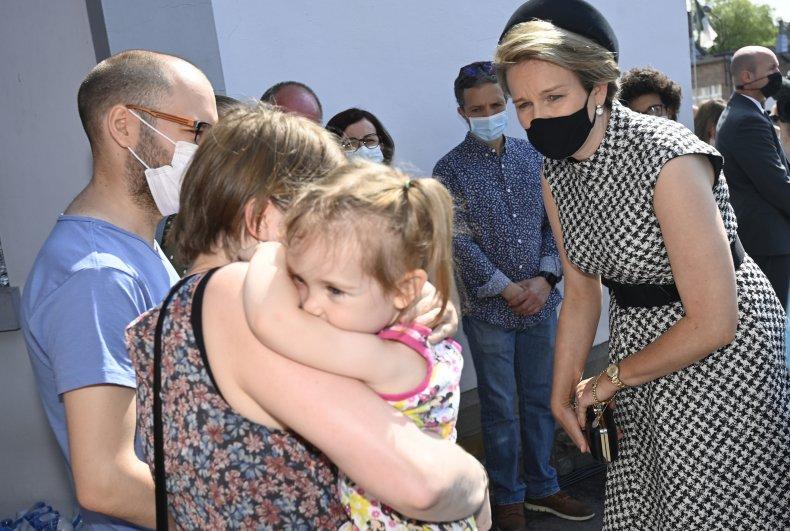 Queen Mathilde comforts victims