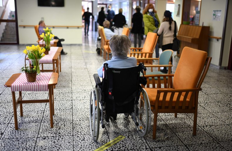 A nursing home resident awaits COVID-19 vaccination.