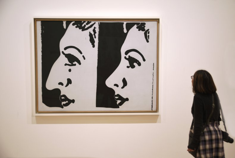A museum visitor admires a 1961 painting