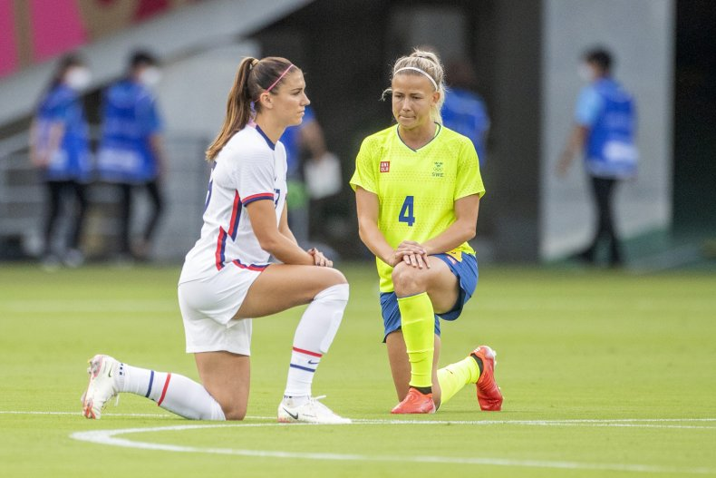 Tokyo 2020 soccer players take the knee