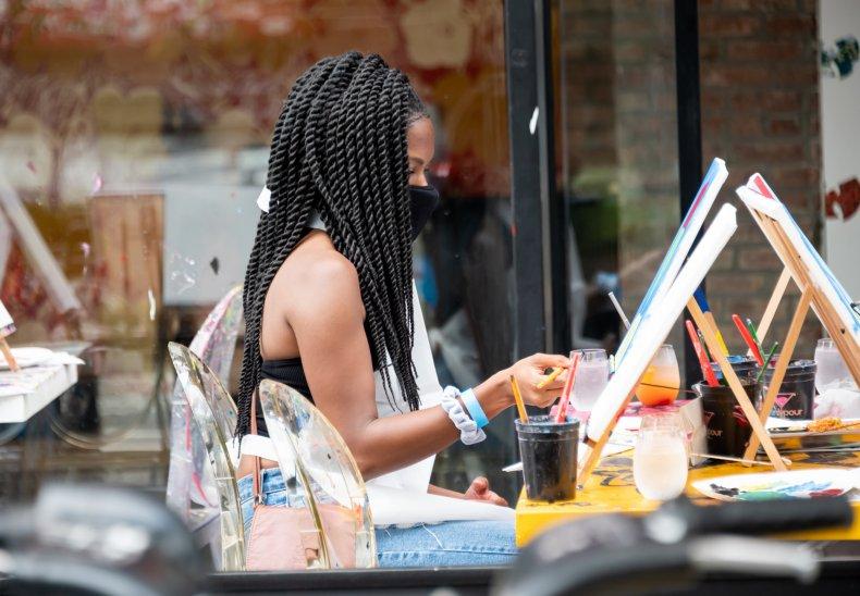 A person paints