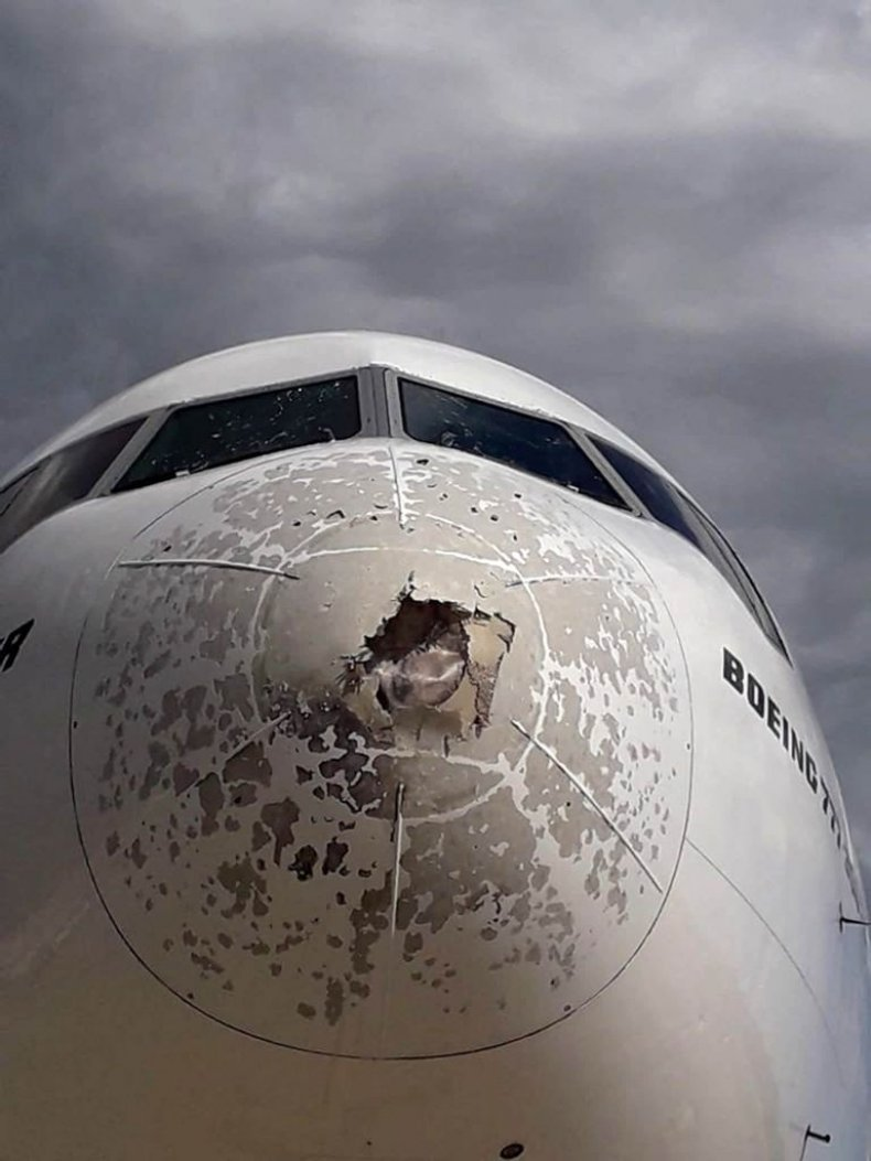 Damage to front of plane from hail