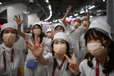 Fans gather outside Tokyo 2020 Olympics stadium