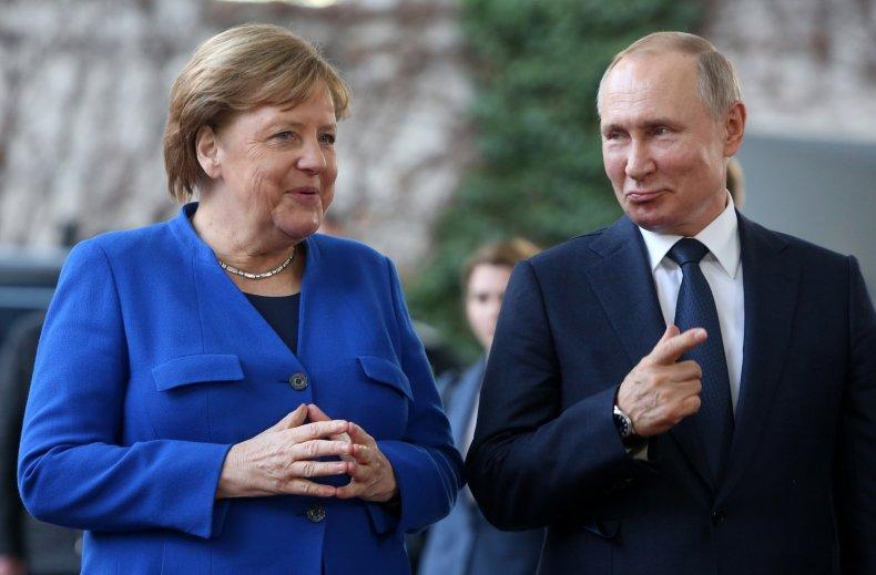 German Chancellor Angela Merkel (CDU, L) greets