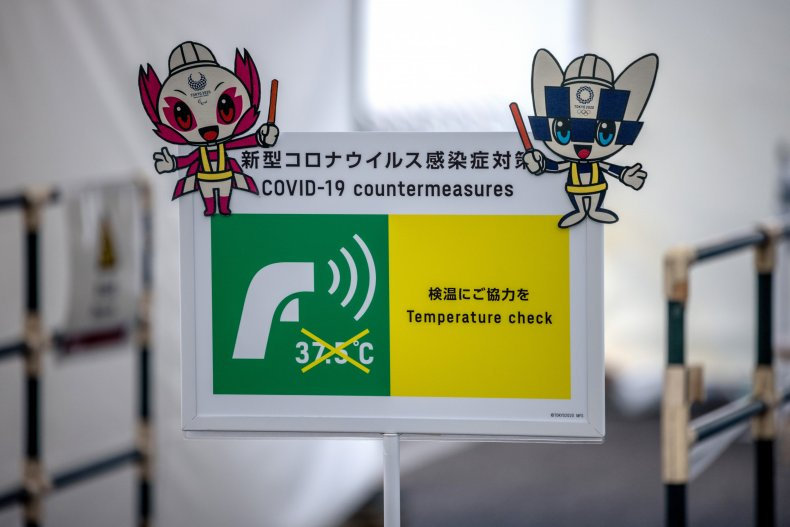 COVID-19 sign at Tokyo Stadium in 2021.