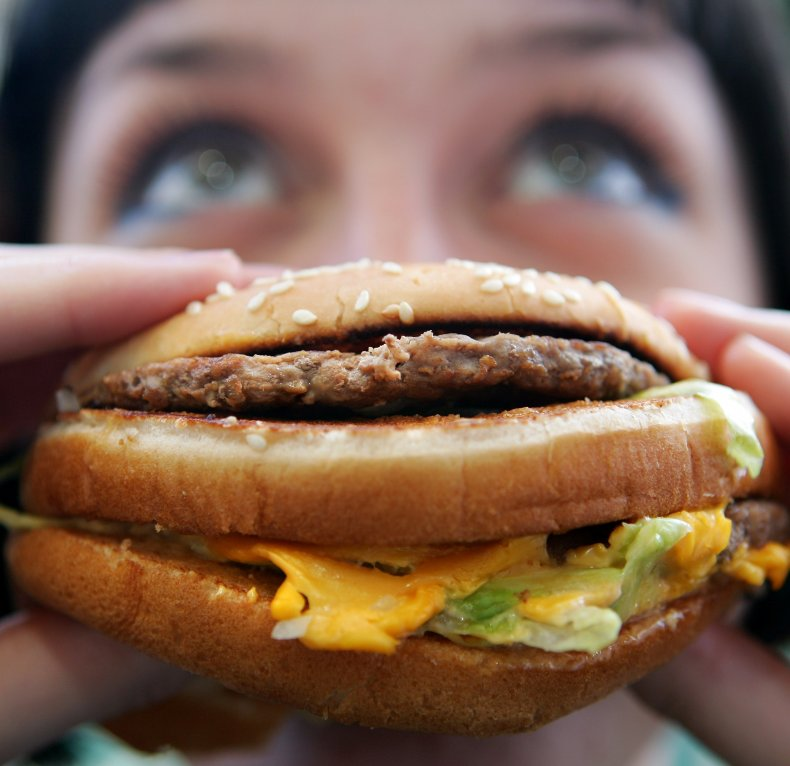 Woman eats a McDonald's burger.
