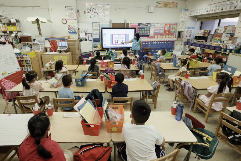 A teacher instructs children in NYC.