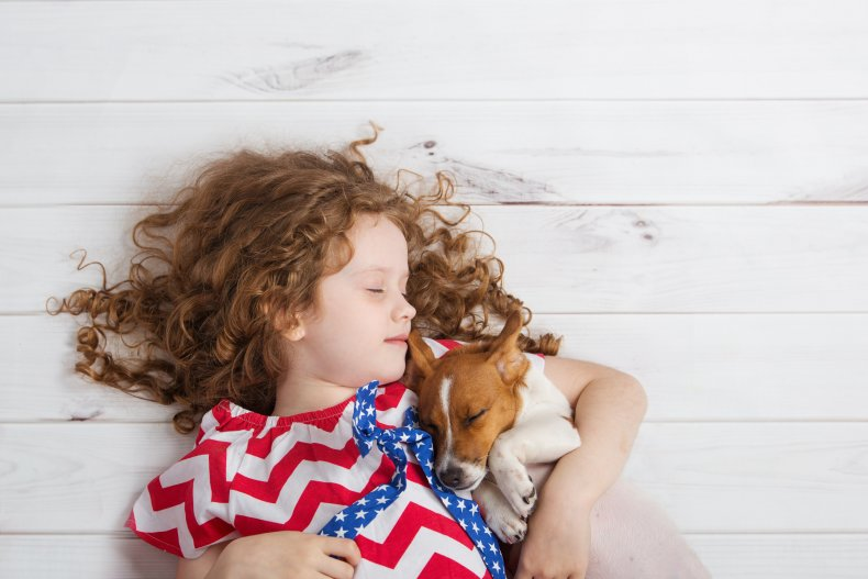 Little girl and dog sleeping