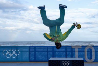 Brazilian surfer Italo Ferreira celebrates gold medal