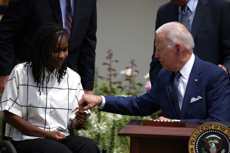 Biden Gives a Pen to Tyree Brown