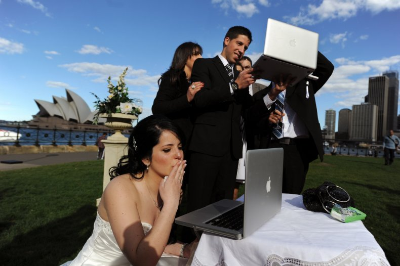 Groom stirs controversy working on laptop