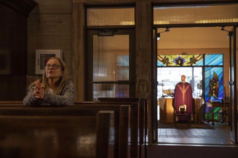 Woman prays alone in church