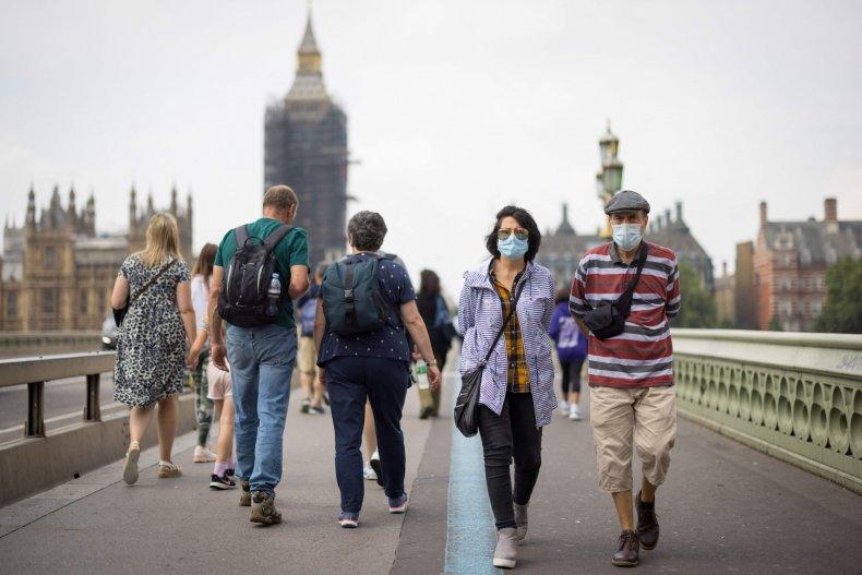 Pedestrians cross Westminster Bridge