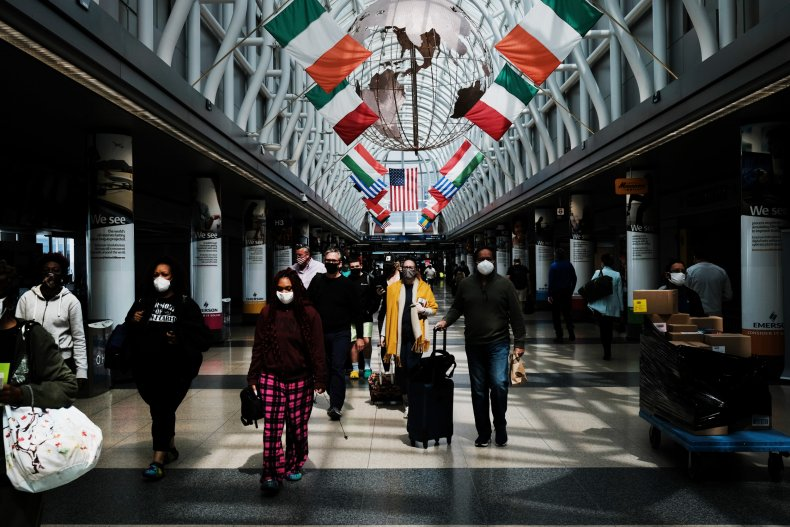 People walking through Chicago's O'Hare airport.