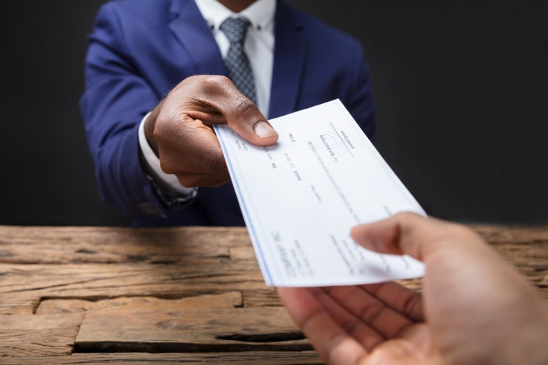 File photo of a paycheck.