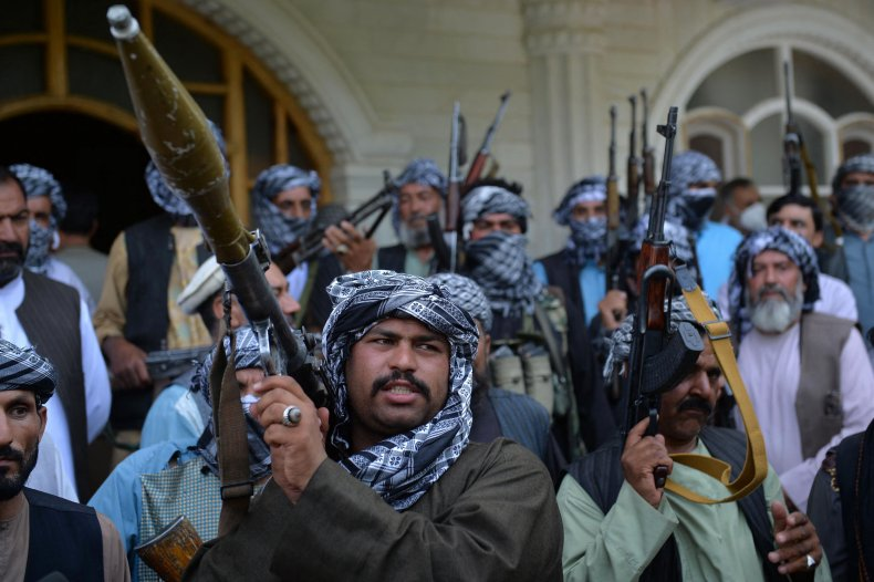 Afghan militia gather with their weapons