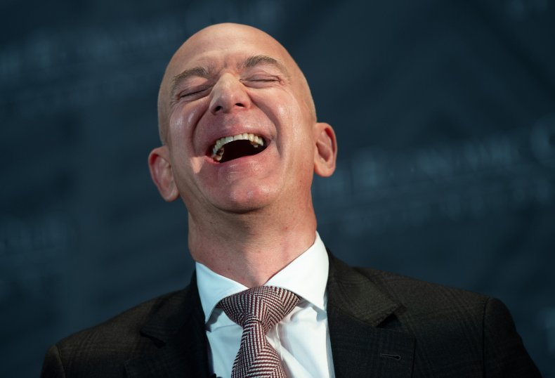 Jeff Bezos laughing in a suit