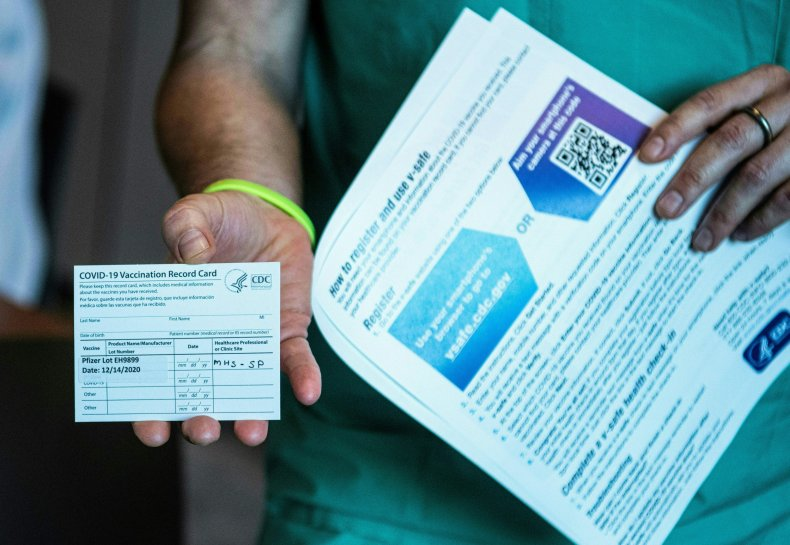 Man shows off vaccination card
