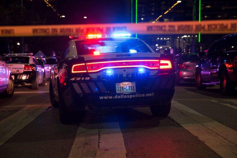 Police cars sit on Main Street Dallas