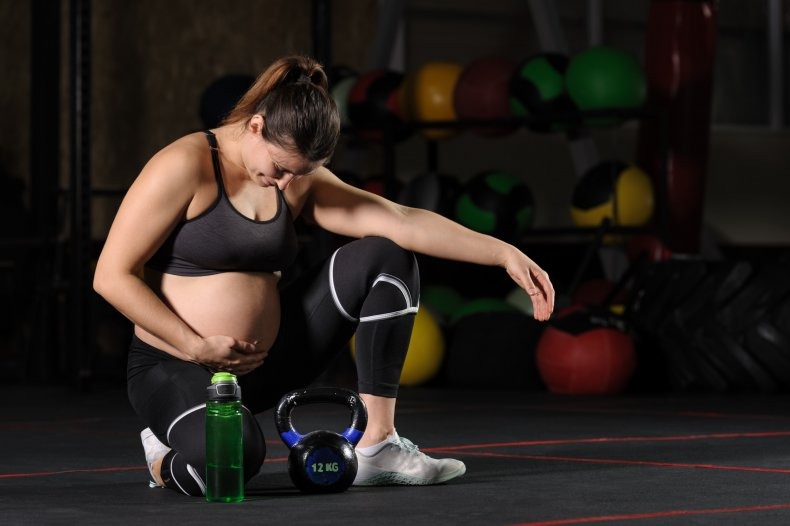 File photo of pregnant woman exercising.
