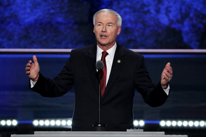 Hutchinson faces backlash as he promotes vaccine
