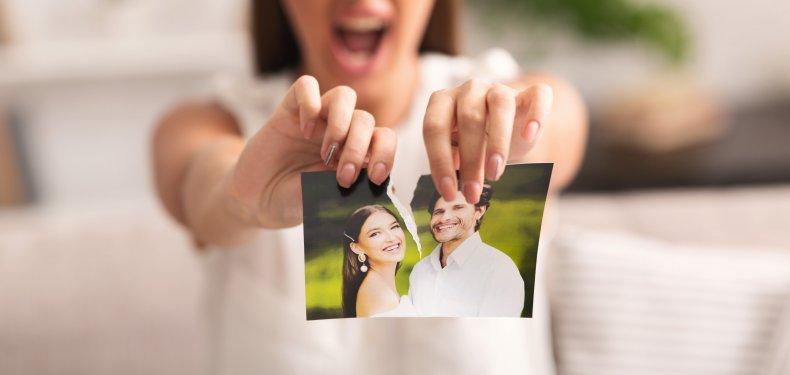 Woman tearing a photograph
