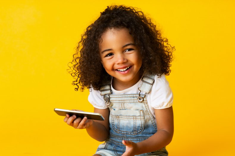 Little girl holding a phone