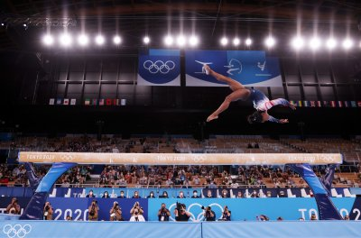 China Gymnasts Clinch Gold, Silver With Biles