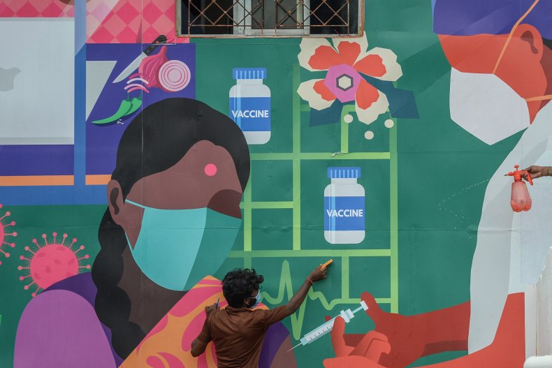 A COVID vaccination mural in India.