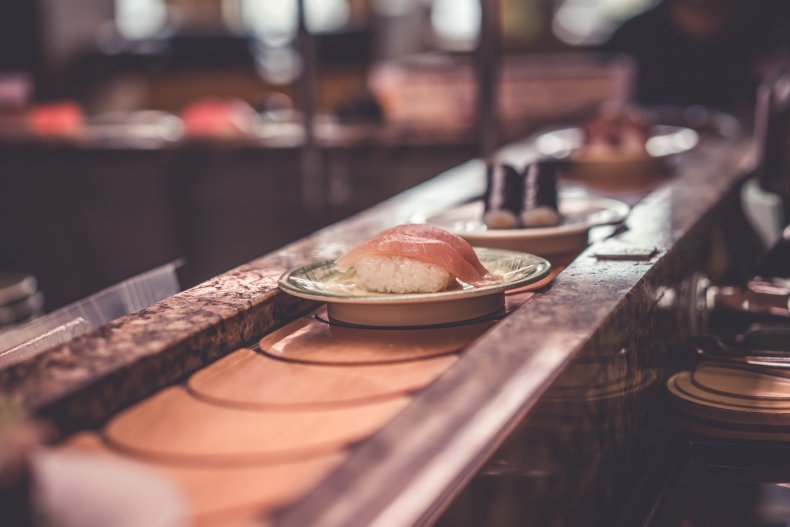 Sushi conveyer belt with food