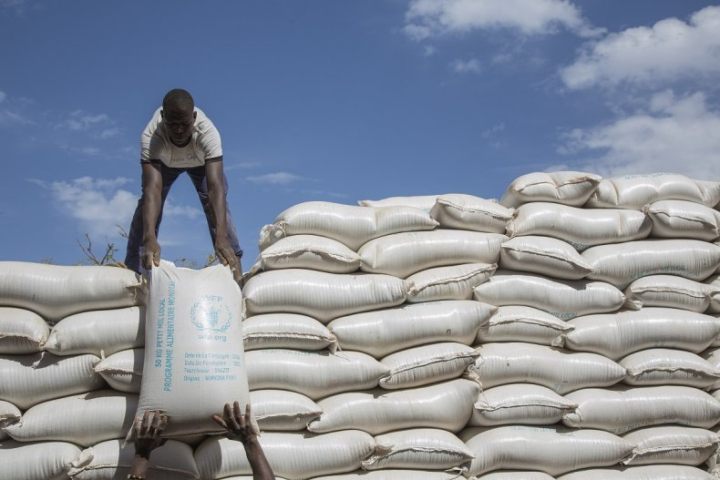Workers offloading flour
