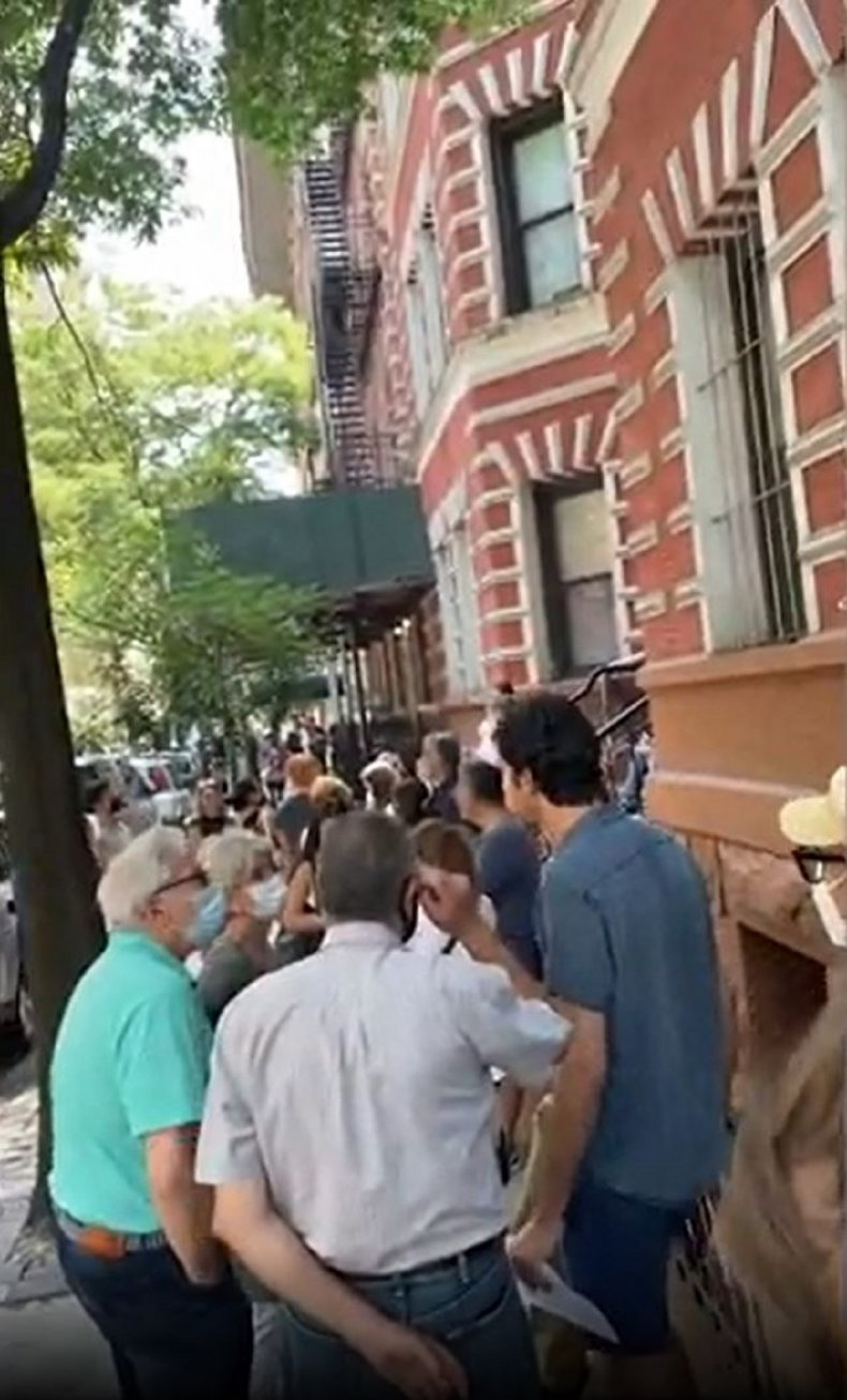 Photo of queue to view NYC apartment.