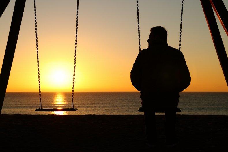 Man Along on Swing at Sunset