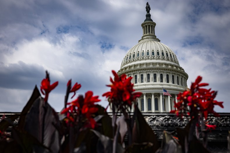 The American flag flies atop the Capitol