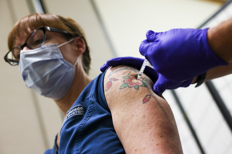 Nurse receives a COVID vaccine