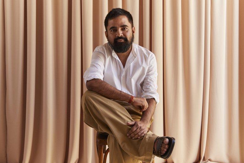 Sabyasachi Mukherjee poses ahead of H&M collection
